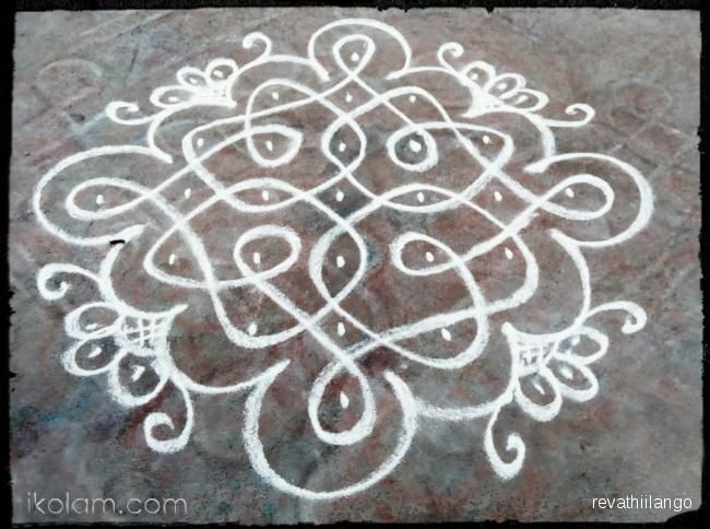 Rangoli Rev's chikku kolam 75. 7 to 1 straight dots. | www.iKolam.com