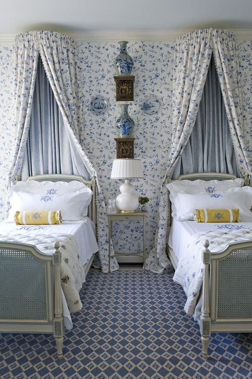 Guest bedroom in Dallas by Cathy Kincaid. The monograms, the canopies, the china, the wallpaper, the yellow bolster pillows.