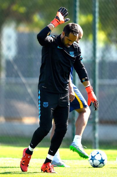 Claudio Bravo of FC Barcelona warms up during a FC Barcelona training session ahead of their UEFA Champions League Group E match against Bayern 04 Leverkusen at Ciutat Esportiva on September 28, 2015 in Barcelona, Catalonia.
