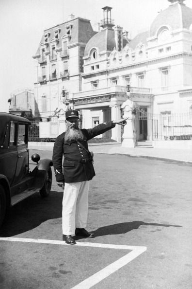 Police officer wearing a beard pointing at the Casino in 1931 in Biarritz France
