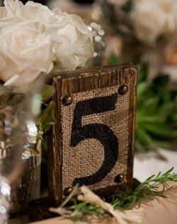 WeddingChannel Galleries: Rustic Table Numbers. Instead of painted numbers house numbers over the burlap