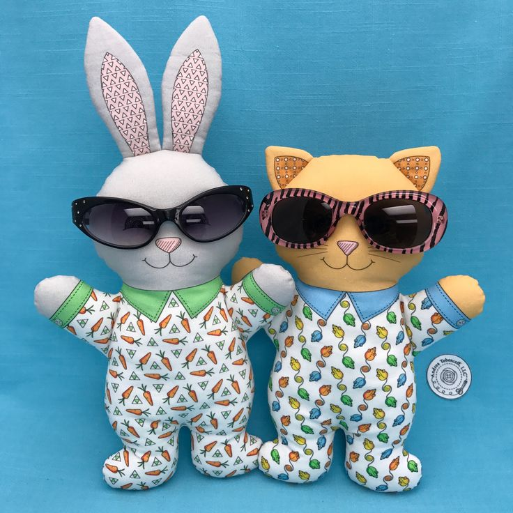 """Bunny in Pajamas"" and ""Cat in Pajamas"" can't decide what to wear for Halloween so they are trying on all the sunglasses. I hope you are getting ready for some Halloween fun. Both toys are Cut and Sew fabric panels that are available in my Spoonflower shop. Link in Profile."