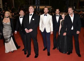 """(FromL) US producer Joel Silver and his wife US producer Karyn Fields, US director Shane Black, Canadian actor Ryan Gosling, US actor Matt Bomer, Australian actress Angourie Rice and New Zealander actor Russell Crowe arrive on May 15, 2016 for the screening of the film """"The Nice Guys"""" at the 69th Cannes Film Festival in Cannes, southern France. / AFP / ALBERTO PIZZOLI"""