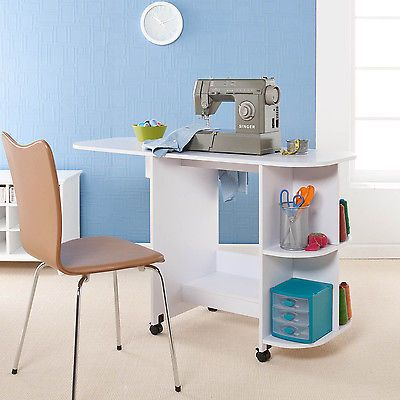 Рriсе - $139.37. NEW White Sewing Table Drop Leaf Extension Folds &Amp; Rolls Storage Compact Shelves ( Type - Sewing Table, Color - White, Dimensions - 29.5 in. H x 31.5 in. W x 19 in. D, Brand - Unbranded, MPN - Other, Features - Folding, Model - OS5669, Country/Region of Manufacture - China, Style - Transitional, Material - particle board, white vinyl veneer, UPC - Does not apply    )