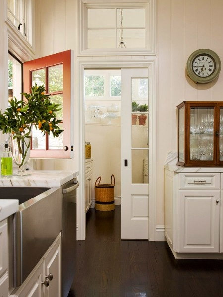 Love the Dutch door, love the pocket door! With 3 highly active escape artists (aka my Westies) I think a Dutch door at the front --rather than the kitchen as shown here-- for accepting packages, etc., is a must. A pocket door, however, I would welcome anywhere!
