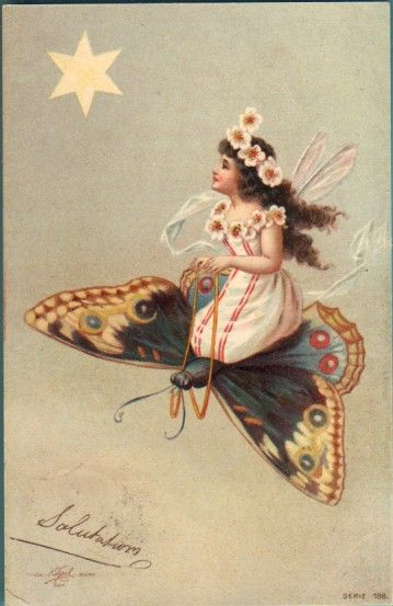 Fairy and butterfly on an antique postcard.