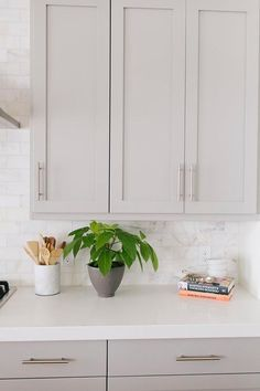 Amazing Kitchen Features Light Gray Cabinets Painted Benjamin Moore Mindful  Gray Paired With Caesarstone Organic White Countertops And A White Marble  Subway ...