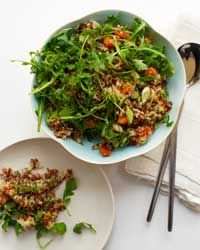 Red Rice and Quinoa Salad with Orange and Pistachios   The salad gets a fruity sweetness from orange juice and zest and is delicious alongside roast chicken.