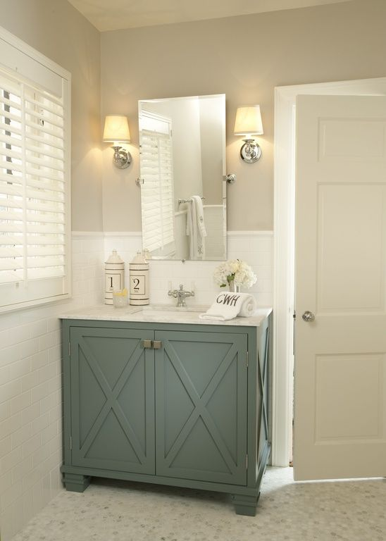 Traditional powder room with vintage rectangular pivot for Bathroom cabinet color ideas