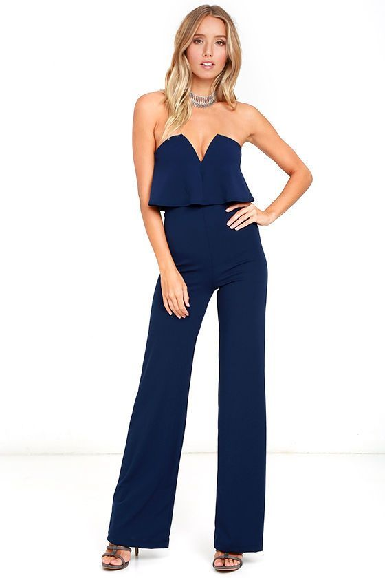 You'll be absolutely irresistible when you're wearing the Power of Love Navy Blue Strapless Jumpsuit! Stretch knit shapes a strapless bodice with a fluttering tier, hidden V-bar, and no-slip strips. A high, fitted waist tops relaxed wide leg pants. Hidden back zipper/hook clasp.
