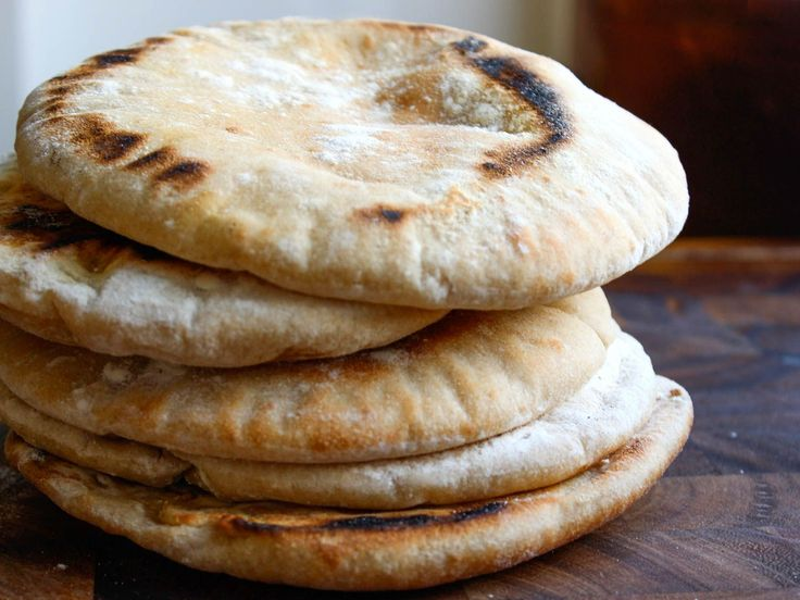 Homemade pita, perfect for splitting and filling with your choice of ingredients, is easy to make at home.