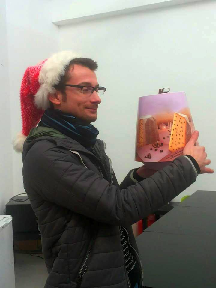 Andrea caressing his pandoro. Christmas arrived also here!