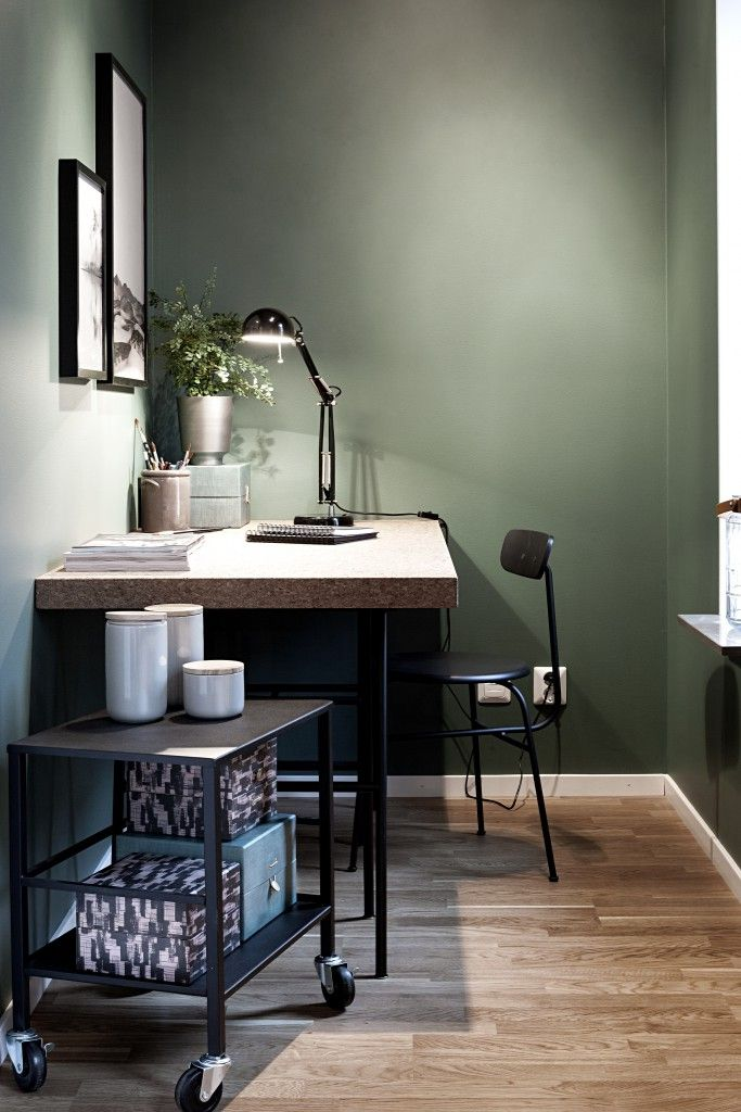 Apartment in Sweden in  dark green and blue tones.
