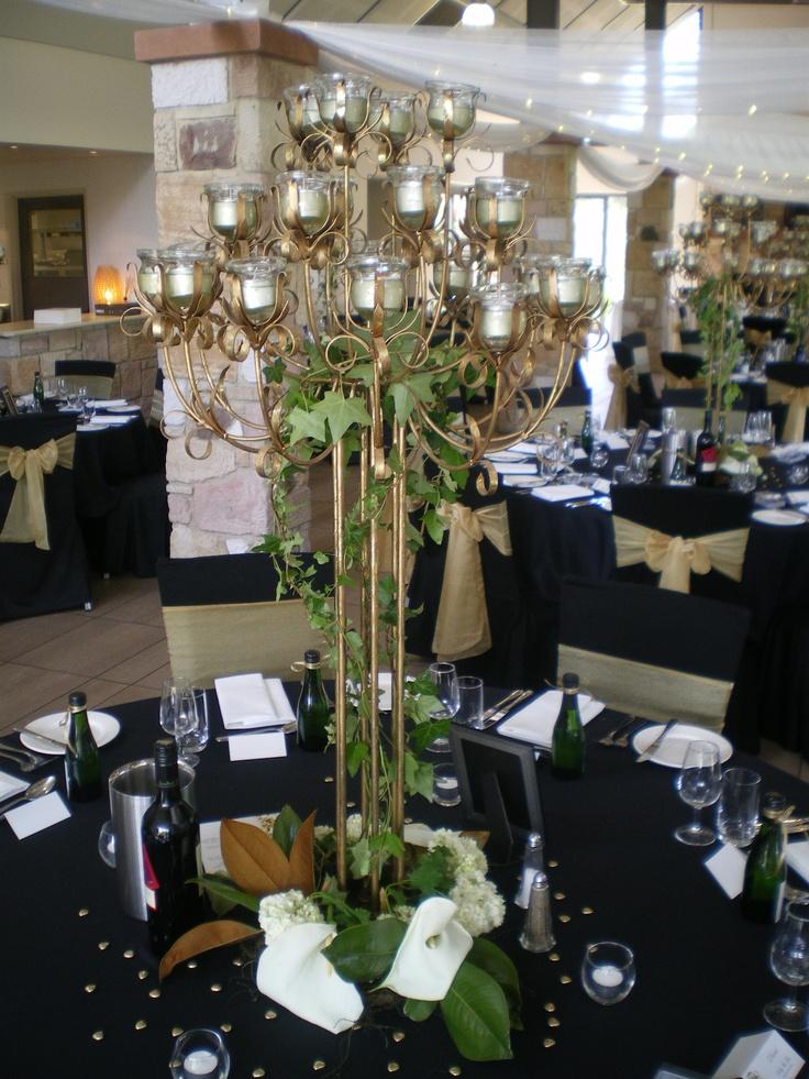 #wedding #weddingreception #centrepiece #candelabra #floralarrangement #lily #chocolatehearts