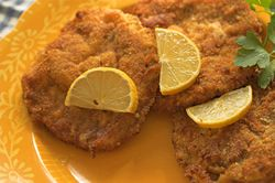 Schnitzels: veal/pork/turkey/chicken: Jäger-Schnitzel: burgundy mushroom/creamy mushroom Zigeuner Schnitzel: red peppers, mushrooms, onions, tomato-paste, red wine, and chicken broth.  Paprika-Schnitzel: tomato-based with paprika and red-peppers.  Käse-Schnitzel: Covered in melted cheese.  Rahm-Schnitzel: Covered in a pepper-cream sauce.  Schnitzel Holstein: Topped with a fried egg, onions, and capers. This is a specialty of Berlin.