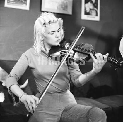 Jayne Mansfield belonged to Mensa and was a concert violinist. She at first thought they hired her to play and, in fact, the first couple of movies she stood there with her violin. She would play for the club sometimes before her shocking death.