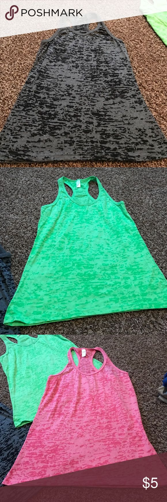 razorback tank Brand new. Only worn once. Have so many clothes just trying to get rid of some. One black, one green, one pink, one orange and one yellow Tops Tank Tops