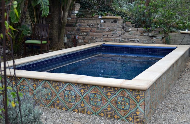The inviting blue of an Endless Pool, complemented by fanciful tile and stone work.