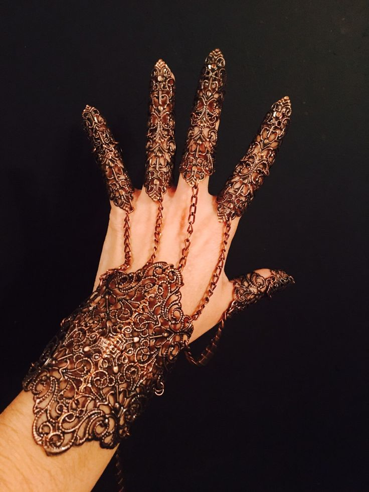 A personal favorite from my Etsy shop https://www.etsy.com/listing/209954326/shield-glove-bracelet-snd-claw-rings-set