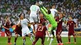 Islam Slimani rises highest to nod Algeria level