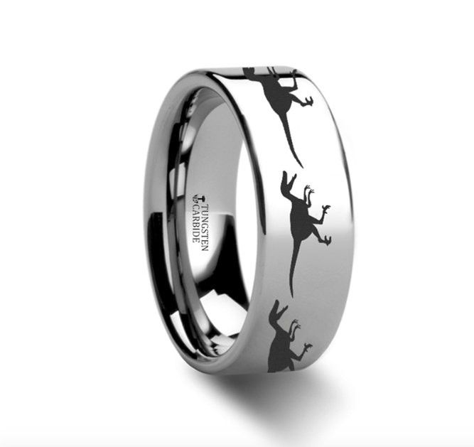This is a precision crafted ring from our line of Comfort Fit Tungsten Carbide Rings with a set of Tyrannosaurus Rex patterns engraved around the entire ring. This dinosaur pattern ring is from our ne