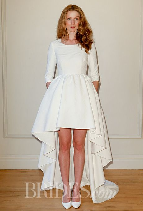 A chic @delphinemanivet wedding dress with 3/4-length sleeves and a high-low hem | Brides.com