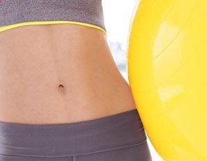 """Shrink Your Belly in 14 Days with a stability ball (""""The research is in! Our fastest ever routine will firm and flatten you from all angles in just 2 weeks"""")"""