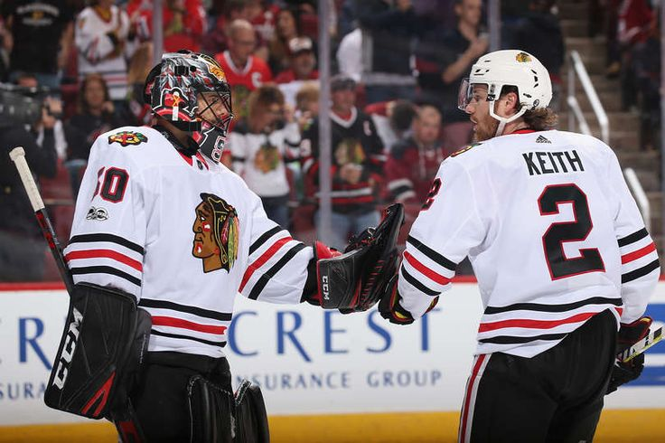 GLENDALE, AZ - OCTOBER 21: Goaltender Corey Crawford #50 of the Chicago Blackhawks high fives Duncan Keith #2 after the Blackhawks scored against the Arizona Coyotes during the third period of the NHL game at Gila River Arena on October 21, 2017 in Glendale, Arizona. The Blackhawks defeated the Coyotes 4-2. (Photo by Christian Petersen/Getty Images)