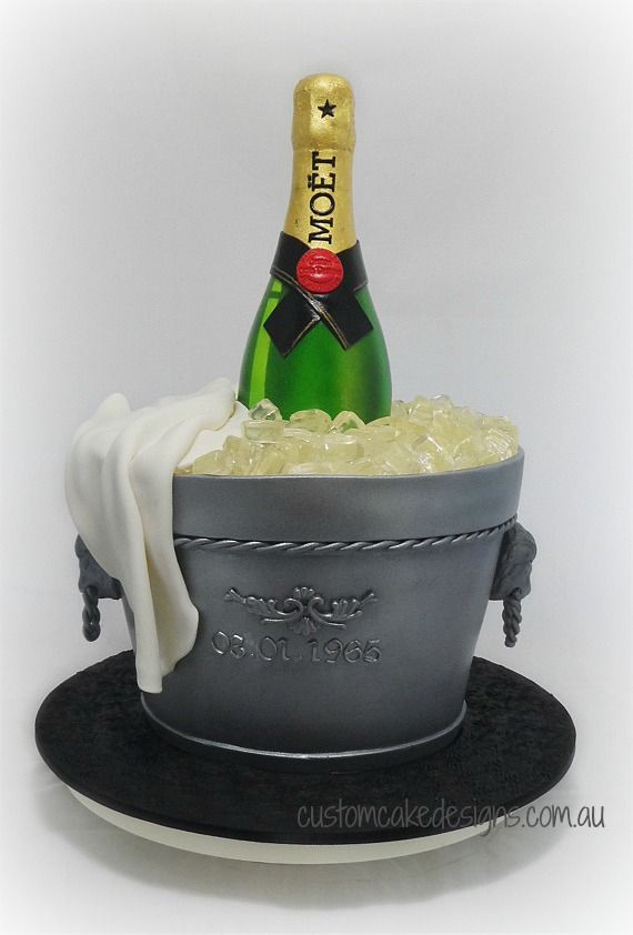 - A bottle of Moet Champagne on ice cake to cater for approx 60 guests.  The cake is 100% edible and the champagne bottle is made from fondant.