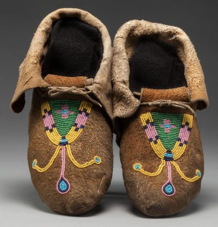 A PAIR OF PLATEAU BEADED HIDE MOCCASINS. c. 1900... (Total: | Lot #71209 | Heritage Auctions