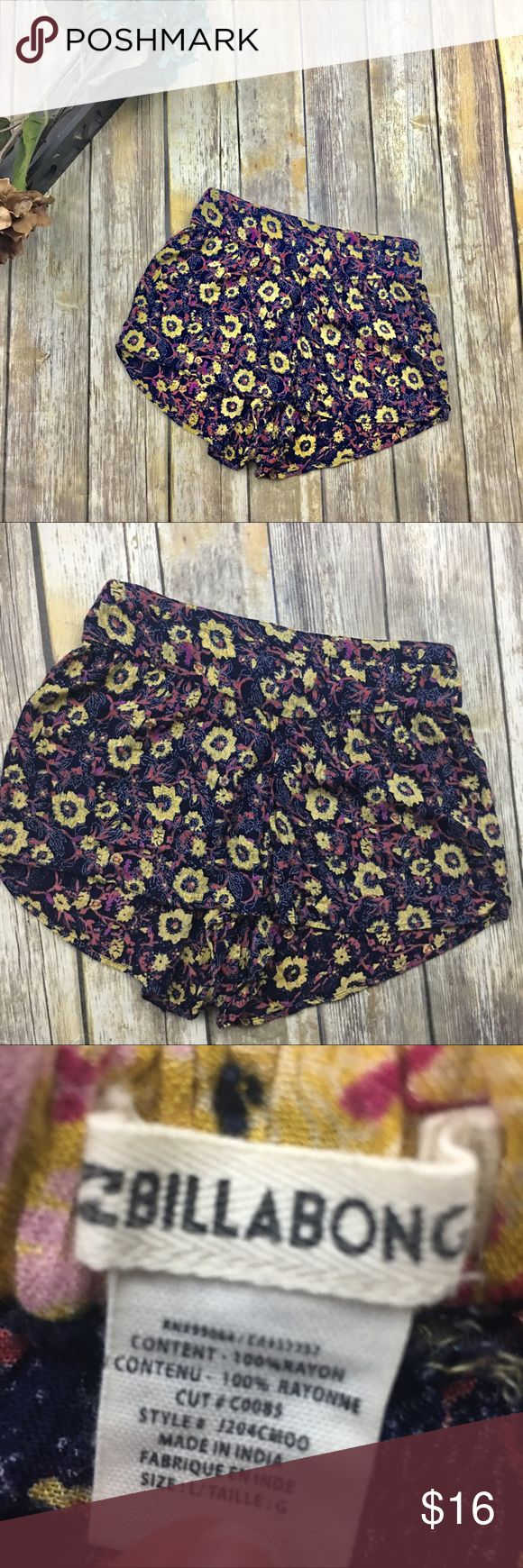 Billabong Trendy flower print shorts Trendy flower print shorts. Navy blue in color with red yellow and purple accent off color. Size large. 100% cotton. 30 inch waist without stretching material. 3 inch inseam. 11 inches from top to bottom of shorts. Billabong Shorts