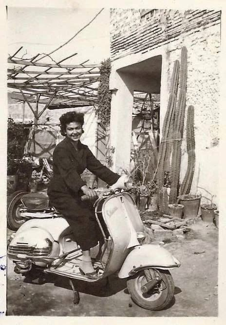 Woman with vespa, 1958