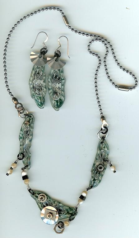 Felice's Pieces. Necklace and earrings made from melted Starbucks cold cup logos.