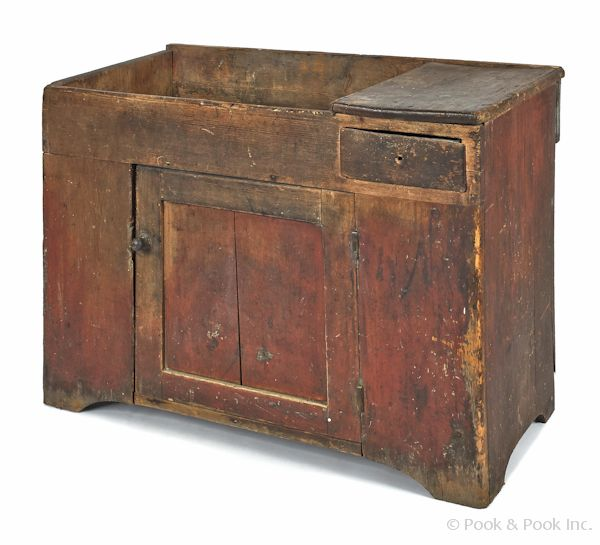"""Pennsylvania painted pine dry sink, 19th c., retaining a red surface, 30"""" h., 40 1/2"""" w."""