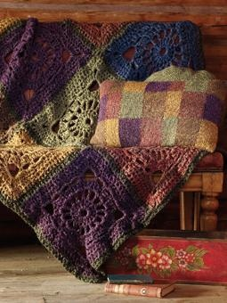 This stunning crochet square throw has been designed by Marie Wallin using Purelife renew in a palette of jewel tones.