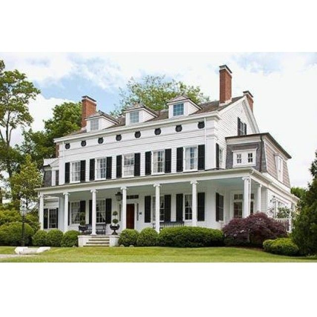 Traditional architecture is honored in this stately Bellport, NY Greek Revival home. - Traditional Home ® / Photo: John Bessler