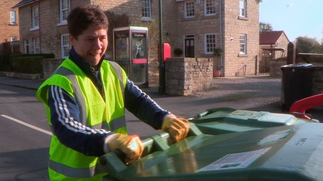 BBC Sport's Nick Hope  joins GB weightlifter and Leeds City Council worker Natasha Perdue  on a refuse collection round in Leeds.  Perdue, who's father Terry competed at the 1968 and 1972 Olympics, watches footage from those historic Games for the first time and reveals her motivations for reaching London 2012.