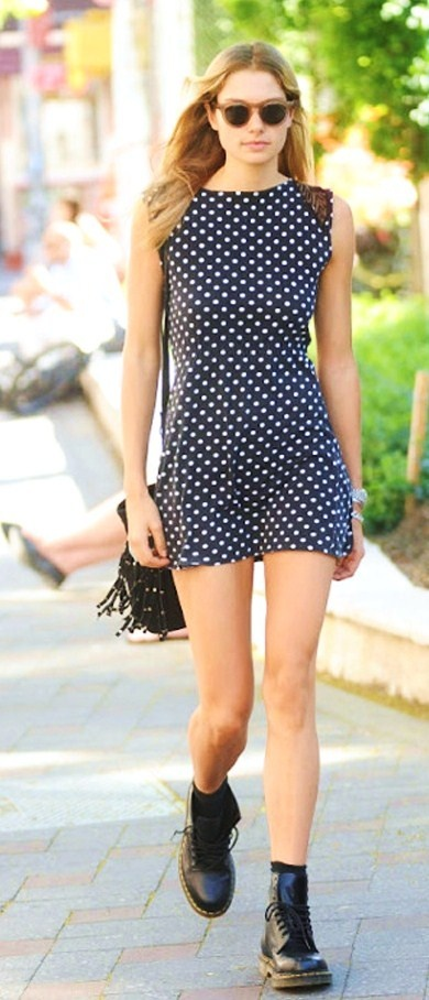 Jessica Hart street style. Love the navy and cream polka dot, especially with the cut of the dress and the lace detail on the shoulder. Paired with simple black Doc Martens, this outfit is simple and I love it.