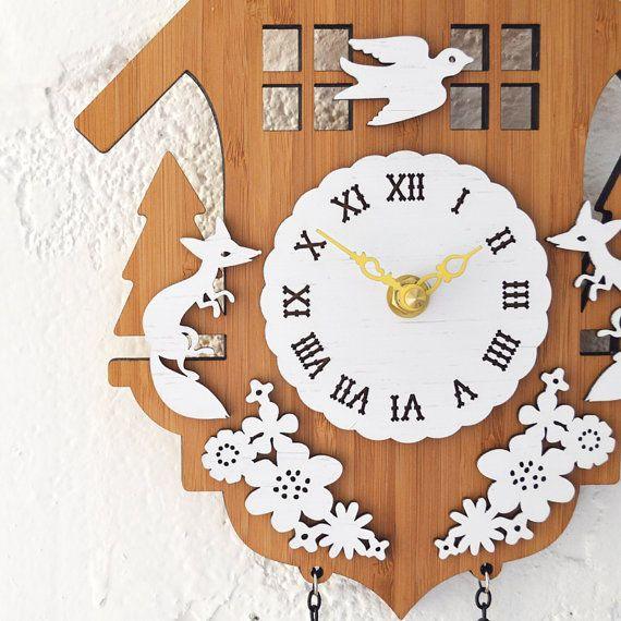 Everything you love about the look of traditional cuckoo clock - the whimsy and the charm are fully intact in this modern take on the timeless design.