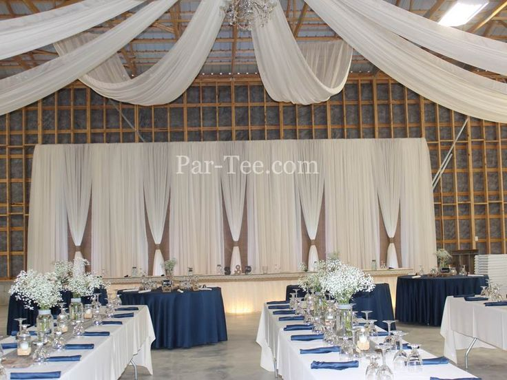 Rustic Wedding Featuring Custom Backdrop and Ceiling Drapery
