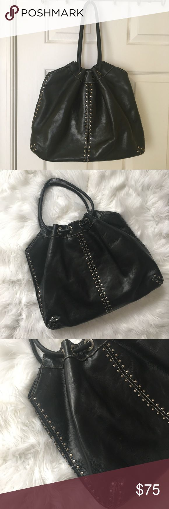 Michael Kors Black Leather Studded Astor Ring Tote Authentic Michael Kors Astor Hobo Bag. Bag has a variety of zip & slip pockets.  Handles: 7.5 in drop Closure: top magnetic snap closure interior  Pockets: one zip pocket, three patch pockets & one accessory pocket  Inside a little dirty from make-up spill. Michael Kors Bags Totes