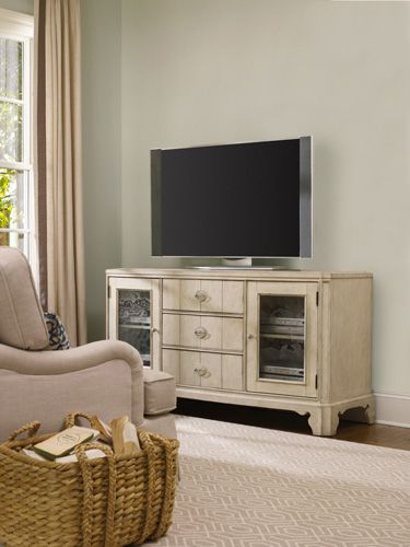 The peacefulness of the outdoors, the tranquility of the sea and the charm of a cozy cottage... this entertainment console features two wood-framed seeded glass doors with one adjustable shelf behind each; one drawer with drop-front; two drawers with removable CD/DVD dividers; one three plug outlet.  Accommodates most 65 inch televisions.