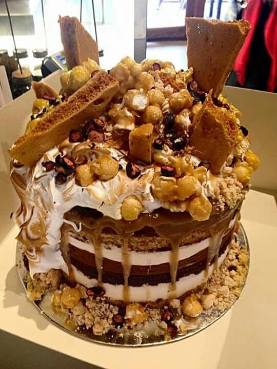 Patissez---Choc caramel mud cake Dark choc mousse,salted butter caramel,milk crumb,torched meringue,butterscotch popcorn,honeycomb & freeze dried blueberries
