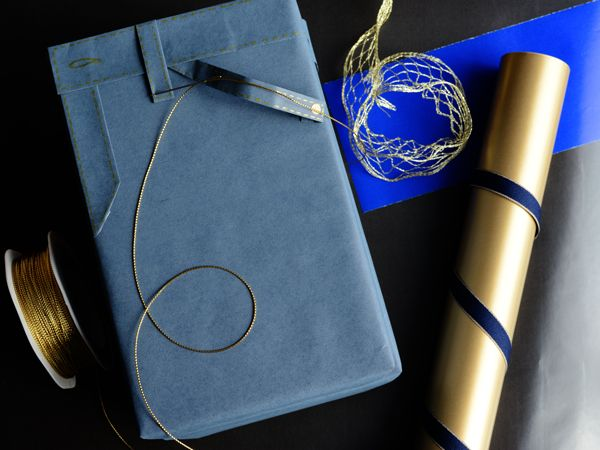Are those jeans? It's wrapping paper.  #Barama #Giftwrap #Giftwrapping #Wrappingpaper #Giftpackaging #Giftideas #Craft #Paper #Creative #DIY #Art #Ribbon #Denim #Gold