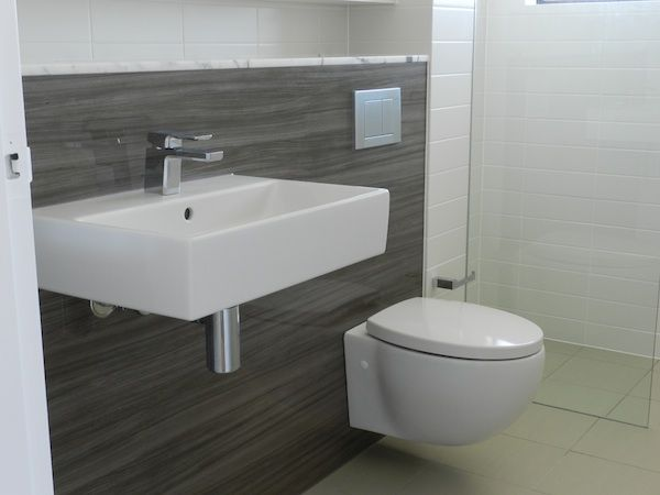 Concealed cisterns give bathrooms a clean-lined look
