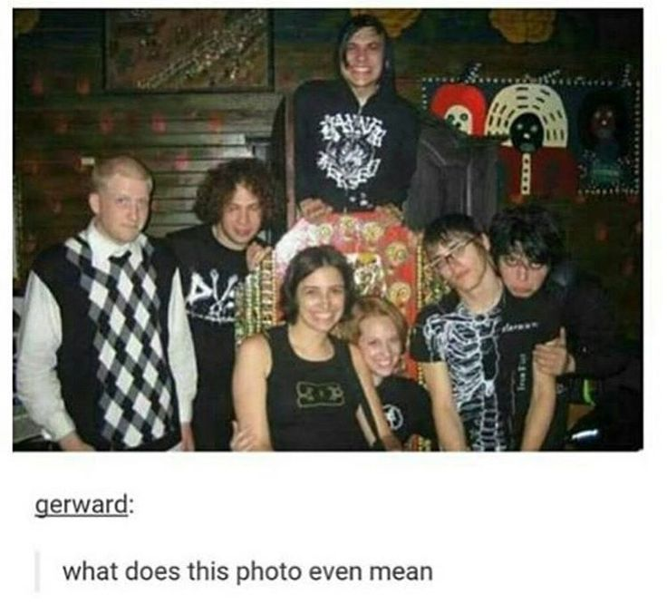 In every photo featuring Bob he looks like a dad who is disappointed in his four mischievous emo sons