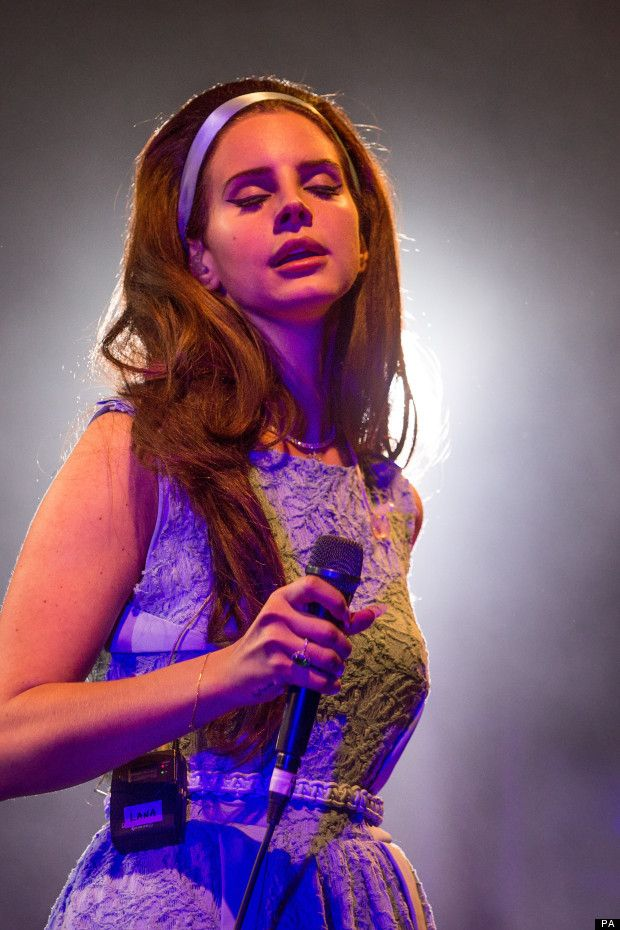 Lana Del Rey performing at the Spin Off Festival - Paradise era, eyes closed - Got your bible, got your gun