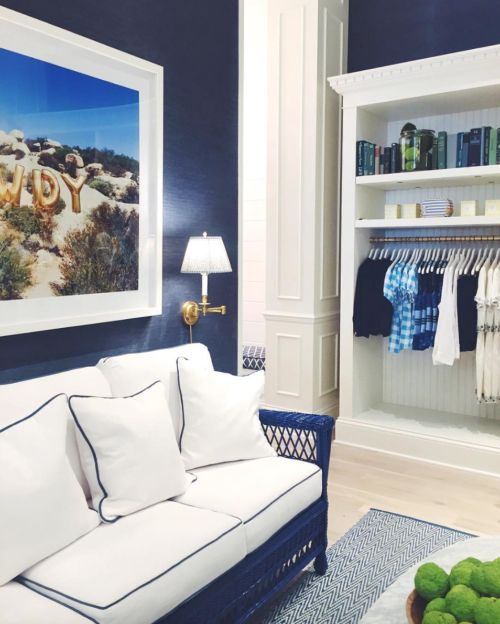 Navy grasscloth walls + Gray Malin print.