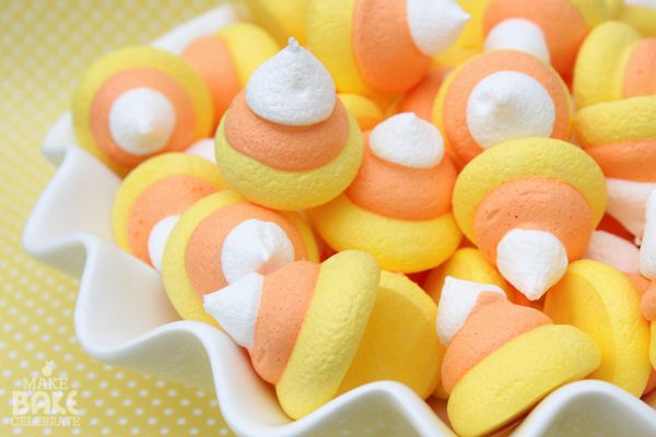 CANDY CORN MERINGUES- I don't know if I like meringue, and I am not a baker, but these are too cute not to pin...makebakecelebrate
