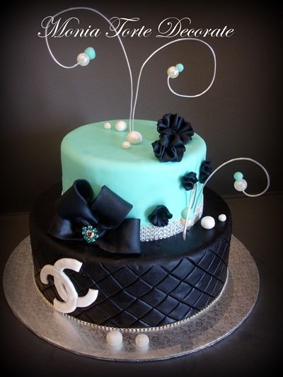 Black and turquoise cake, quilted, pearls, bling, channel with pretty bow.